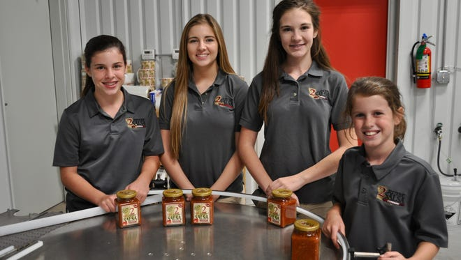 (From left) Sarah Deshotels, Shelie Canoe, Rayne Canoe and Emily Deshotels stand in 2Sisters' new facility where they spent their summer making salsa.