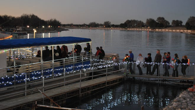 People board a boat to begin their 2014 Christmas on the Pecos tour. Tickets for 2015 will go on sale Thursday.