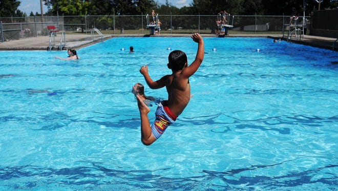 Zachary Vandewater, 5, of Sioux Falls, jumps into the pool on Tuesday, Aug. 11, 2015, at the Kuehn Park Pool in Sioux Falls. All but two Sioux Falls pools--the Kuehn Park pool and the Terrace Park Family Aquatic Center--will close by Aug. 23. The pools at Terrace and Kuehn parks will be open through Sept. 6.