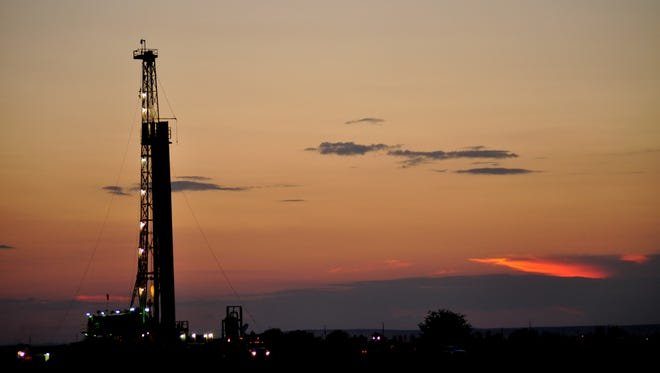 An exploration rig rises above the horizon on Grandi Road in Carlsbad, New Mexico