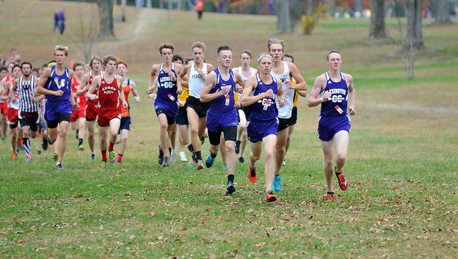 The Lexington boys cross country team fires out to the lead in the Division II district race at Galion. The Minutemen won Saturday's Division II regional meet at Tiffin's Hedges Boyer Park