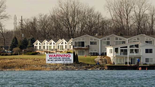 A sign on the shore of the St. Clair River in Marysville warns boaters of pipelines under the St. Clair River Friday, Jan. 2, 2015, as seen from Corunna, Ontario.