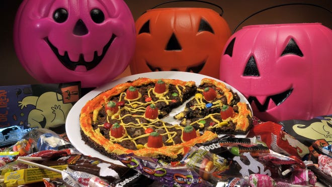 Brownie candy pizza is a tasty way to use up all that leftover Halloween candy.