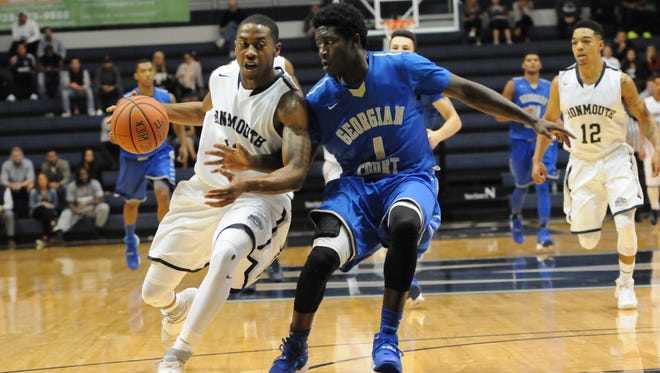 Je'lon Hornbeak drives to the basket against Georgian Court on Saturday night. Monmouth University defeated the Lions, 107-77