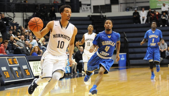 Micah Seaborn drives to the basket during Monmouth University's exhibition win over Georgian Court on Saturday night