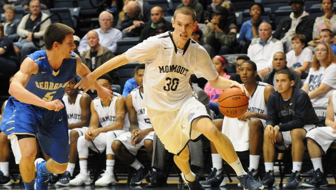 Monmouth University's Collin Stewart drives to the basket against Georgian Court on Nov. 7.