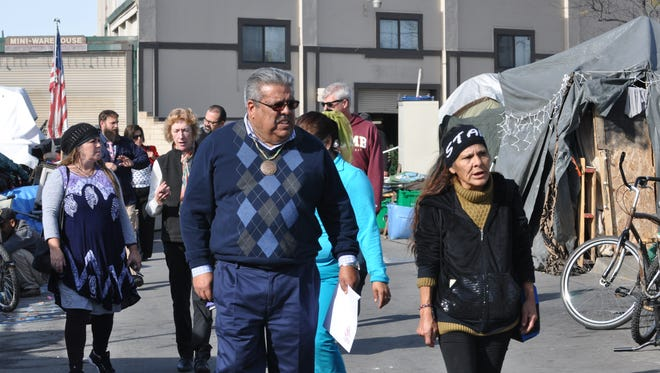 Homeless advocate Diana Soto, right, speaks with District 1 Supervisor Fernando Armenta during Monday's survey of the Soledad Street neighborhood in Chinatown.