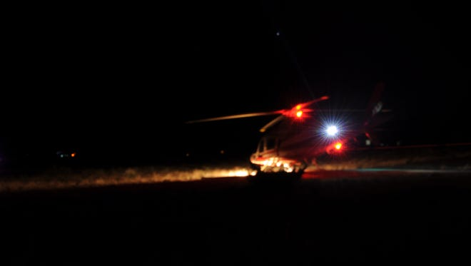 A Life Flight helicopter prepares to take off and help survey the fire on Guadalupe Peak Tuesday night that was originally attributed to a plane crash.