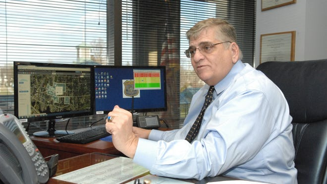 In this file photo from January, Ocean County Sheriff Michael G. Mastronardy uses software (displayed on computer screen) to monitor all mobile social media platforms for any signs of criminal or terror activity and people in distress.