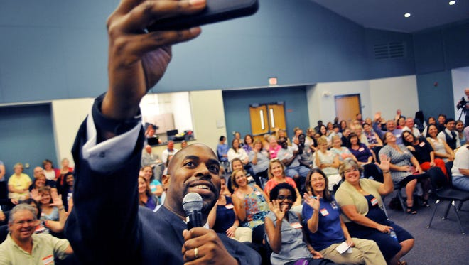 Desmond K. Blackburn, Ph.D. new Brevard Public School Superintendent takes a selfie with the crowd during a meet and greet Tuesday night at  Space coast Jr Sr High school in Port St John auditorium around 100 people came out for the event .