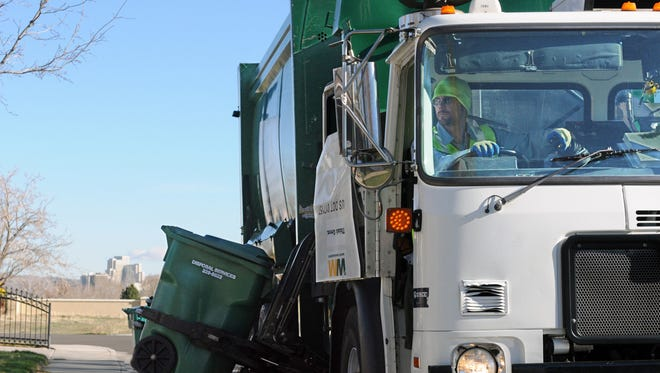 Waste Management's Nick Dees collects garbage in Reno.