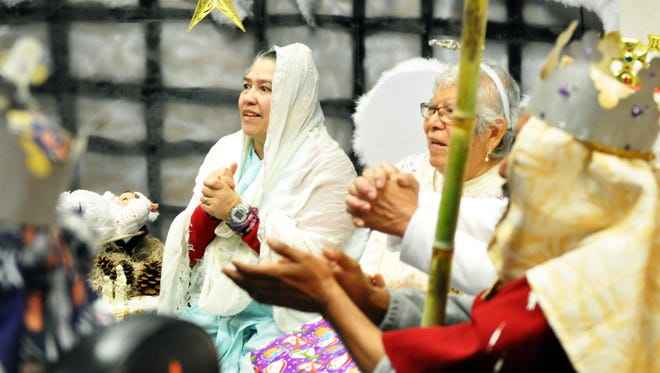 Participants dressed as Biblical figures give thanks to a singing group from St. Mary's Church. La Casa Adult Day Health Center in Salinas had its annual posadas on Christmas Eve.