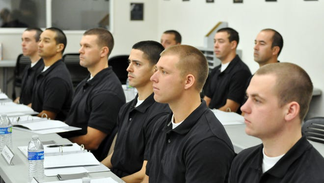 Salinas firefighters listen to Chief Ed Rodriguez on Tuesday during a training session at Fire Station 3.