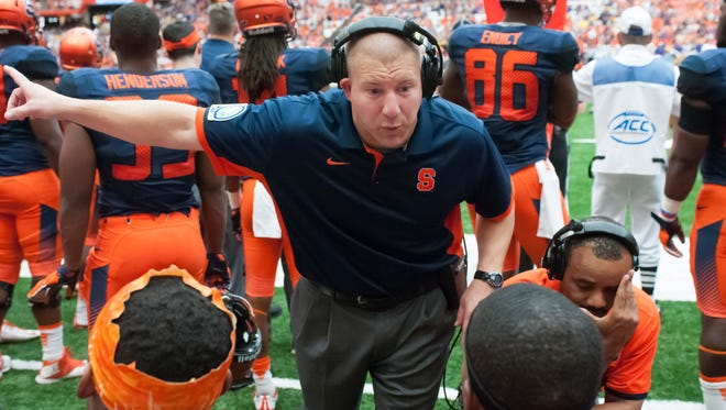 Sep 26, 2015; Syracuse, NY, USA; Syracuse Orange defensive line coach Tim Daoust instructs his players during the fourth quarter of a game against the LSU Tigers at the Carrier Dome. LSU won the game 34-24.