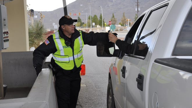 A White Sands Missile Range gate guard checks identifications at the WSMR Las Cruces gate. On Jan. 11, New Mexico was declared a non-compliant REAL ID state. Due to New Mexico's recent non-compliance, visitors who attempt to gain access to the installation must provide an additional form of identification aside from their New Mexico identification.