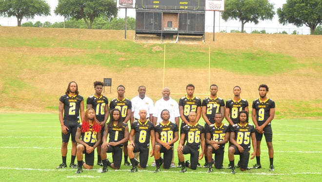 Former Grambling wide receivers coach Mickey Joseph, center, poses for a photo with the Tigers' receivers in 2015. Joseph left for Louisiana Tech last week.