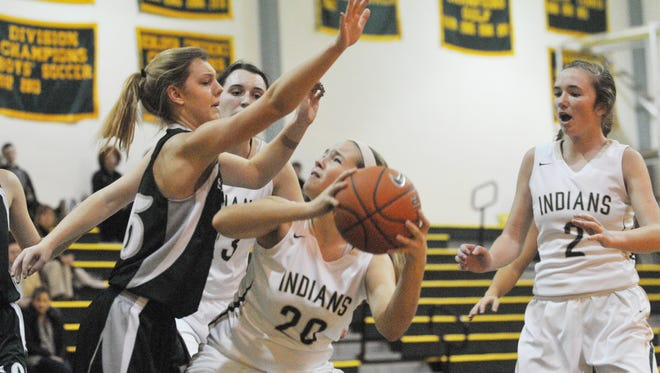 Indian River's Braydee Whitman attempts a shot after grabbing an offensive rebound against Salisbury School on Wednesday in Dagsboro