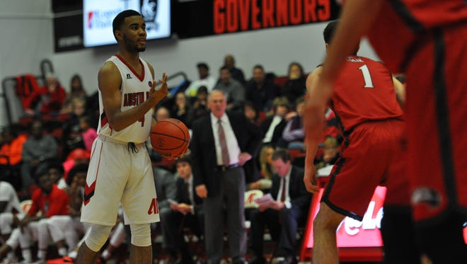 Josh Robinson pauses and asks for his teammates to move around in the first half of the SIUE game on Thursday, Jan. 21.
