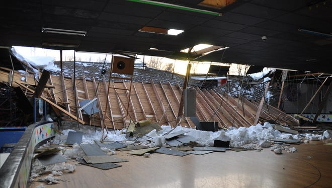 Interior view of the RollerMagic South Amboy Arena after part of the rear roof collapsed.