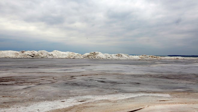Ice piles along the shore of Port Clinton. Ice conditions on area lakes and rivers are unstable, the Coast Guard said.