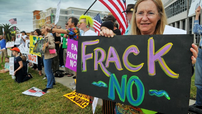Barbara Venuto of Merritt Island part of the No Fracking protesters that line the streets and sidewalks in Cape Canaveral in front of the SCM Professional Complex during a protest against fracking earlier this year.