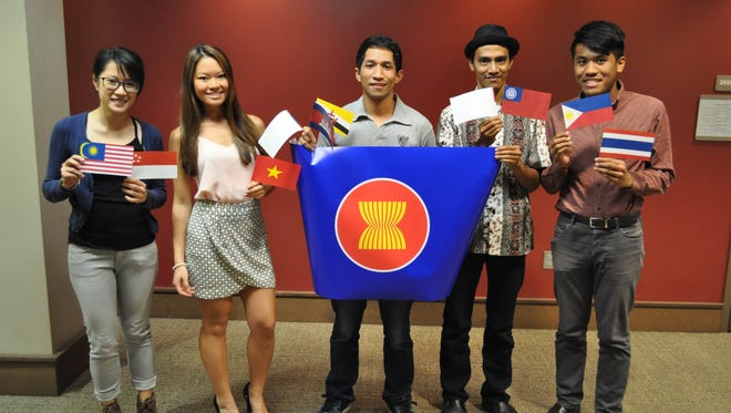 Members of the Indonesian Student Association proudly hold the flags of their countries.