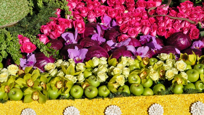 Apples, cabbage, orchids, roses and seeds on a Rose Parade float.