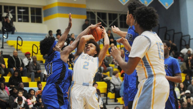 Cape Henlopen's Demetrius Price (2) goes for a layup against Dover's Michael Douglas (11) on Tuesday in Lewes.