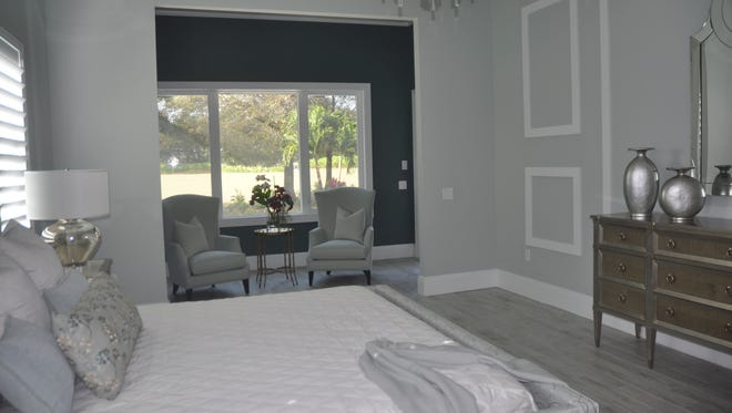 The master bedroom has a sitting room that leads out to the lanai