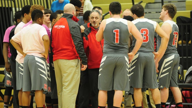 Port Huron head coach Tony Giancarlo talks with his team during a timeout against Romeo at L'Anse Creuse North on March 7.