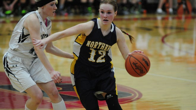 Port Huron Northern junior guard Kathleen O'Connor looks for an open teammate against Waterford Kettering on March 8, 2016.