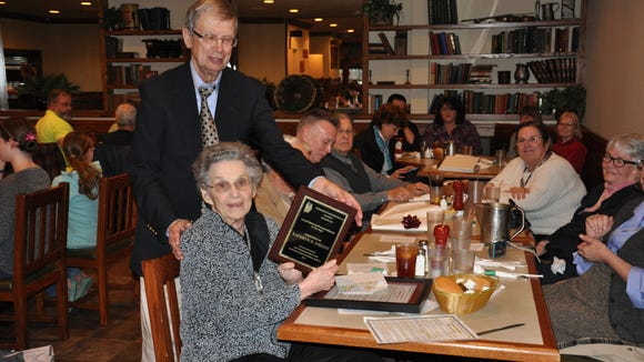 Kathryn Jordan, 97, holds a plaque recognizing her service with the Stewartstown Historical Society and the local history community. Historical society member Roger Wilson is seen with Kathryn Jordan.