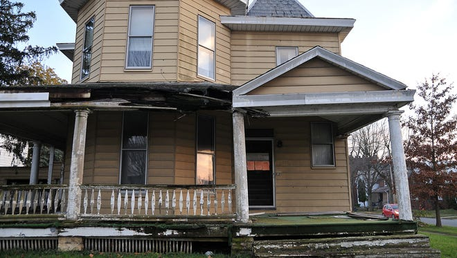 A vacant home at the intersection of West Mansfield and Spring streets.