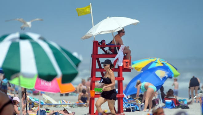 Crowds pack Cocoa Beach for the 52nd annual Easter Surf festival held at Lori Wilson Park.
