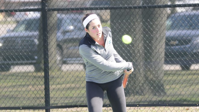 Layla Samman keeps her eye on the ball as she prepares to hit a backhand during Port Huron Northern tennis practice