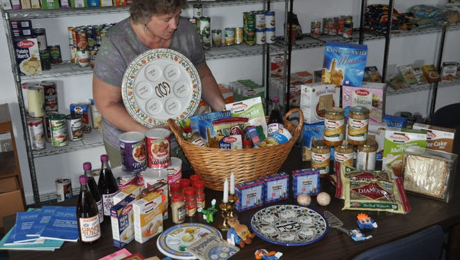 Lisa Pietruszewicz packages several Passover-related basket for the eight-day holiday
