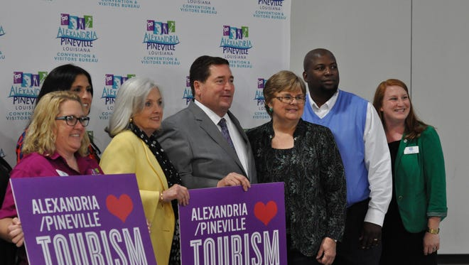 Lt. Governor Billy Nungesser (middle) poses with Alexandria/Pineville Area Convention & Visitors Bureau staff Wednesday after his speaking appearance in Alexandria.