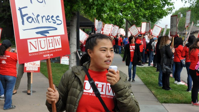 As seen at 8:00 AM Tuesday morning, May 17th, striking workers participating in an ongoing contract dispute man pickets in front of Salinas Valley Memorial Hospital.