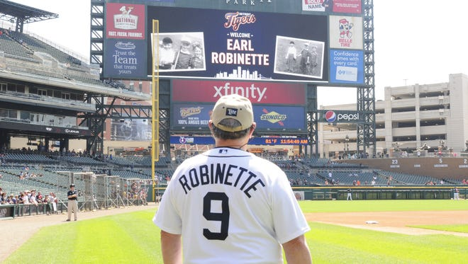 Earl Robinette stares at the scoreboard welcoming him to Comerica Park after signing a one day contract with the Detroit Tigers on May 25, 2016.