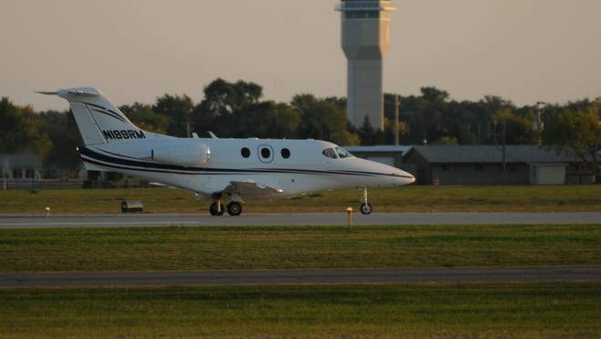 A private Raytheon Premier twin engine jet piloted by Robert Garriott and Marcy Garriott take off from Wittman Regional Airport after they refueled Sept. 21, 2008 on their way to Manchester, NH.