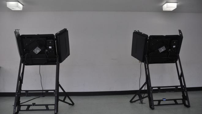 Voting booths at the South Marshall precinct remained unused for much of Election Day on June 7.