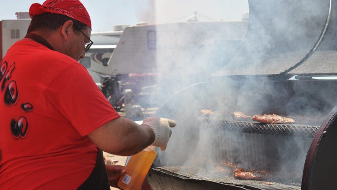 A 2013 contestant works on his BBQ.