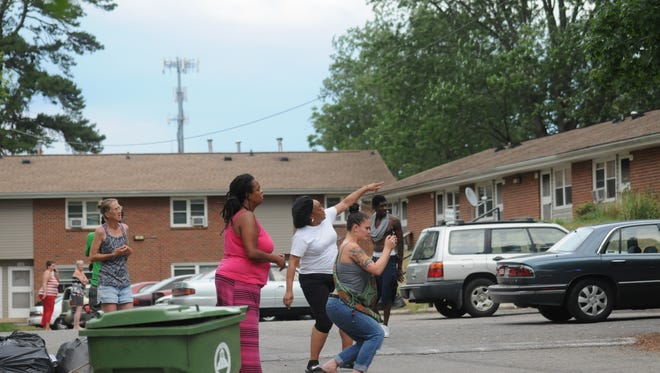 """Several residents at Deaverview Apartments react to an officer-involved shooting Saturday, July 2, 2016. Many were yelling """"Black lives matter."""""""