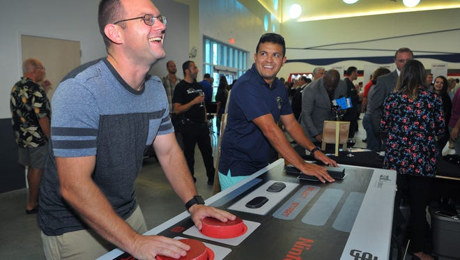 Matt Mong of Cocoa and David Moreno of Viera play a giant Nintendo Game made by 321Millennials during the One Nation: American Innovation hosted by FLORIDA TODAY  and the USA TODAY network and presented by Harris Corporation event held Wednesday night at Cruise Terminal 1 Port Canaveral .