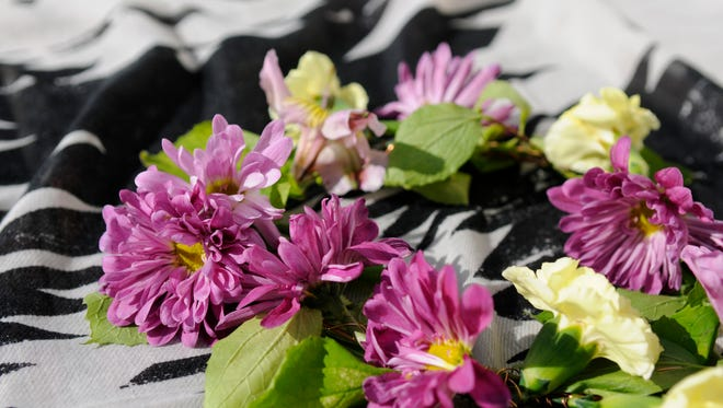A bohemian DIY flower crown -- the perfect accompaniment to wear outside in the summertime, whether it's at a party or on the beach with friends.
