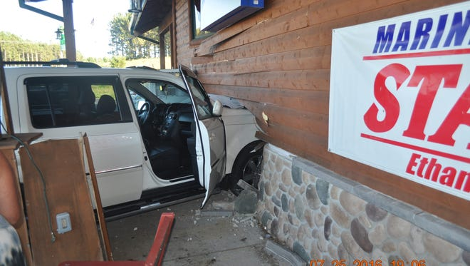 The front of an SUV sticks through a wall at Pritzl's Trading Post, 251 State 13, Rome, Monday evening.