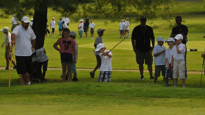 Golfers compete in a skills challenge on the last day of the First Tee Golf program Friday, July 26, 2013.