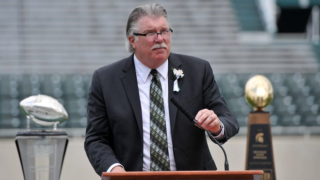 Jim Cotter speaks at the memorial service for Mike Sadler Sunday, July 31, 2016. The star punter was killed in a car crash July 23rd.