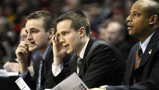 Jordan Ott, middle, sits on the bench with Michigan State coaches during the 2010 NCAA men's basketball tournament. Ott is now an assistant coach for the Brooklyn Nets.