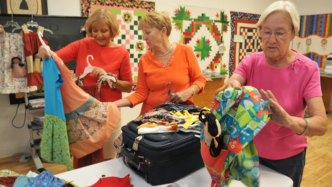 MariAnne Bailey, Brevard chapter founder, Sue Wojeicki, and Aldoan Dulskis.The Brevard Chapter of Dress a Girl have created dresses, and little dolls to go with them, for girls in need all over the world. The group meets at Sew Central in Merritt Island.